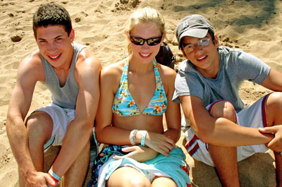 2 boys and girl on beach